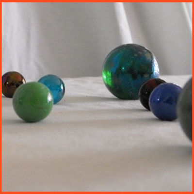 Using marbles to teach Third Law of Motion