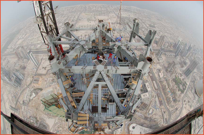 From the spire of the Burj Khalifa building in Dubai during construction